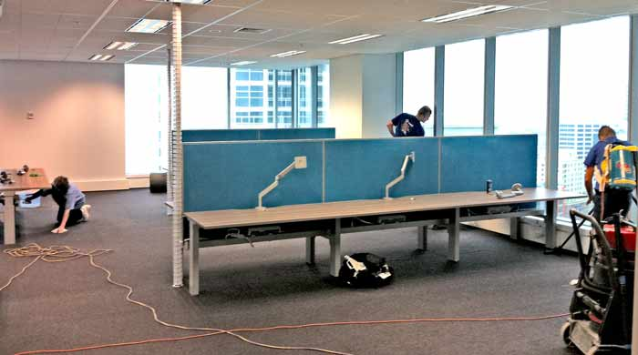Simpo staff doing an after builders clean for Lend Lease at an Office located in george st, Sydney NSW 2000