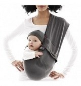 cute baby carried in a sling by mum