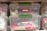 baby storage containers full of baby clothes